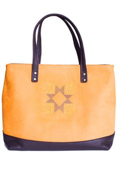 If you are an active person with a dinamic lifestyle the All Day tote bag is your perfect choice! Spacious, practical and timelessly elegant, this handmade handbag in nubuck leather will help you keep all your essentials organized and shortly will become your favourite everyday accessory. #busta #bustabags #leatherbag #leather #streetstyle #blue #yellow #embroidery #folklore #handmade #tote #leathertote #bag #office #attire #clothes
