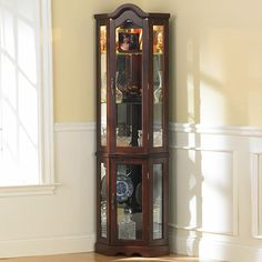 Amazon.com - Southern Enterprises Lighted Corner Display Cabinet, Mahogany - Curio Cabinets
