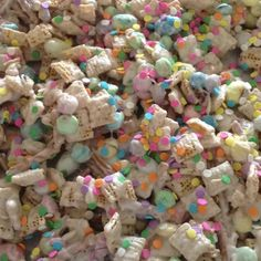 Easter chex mix!!    2 cups each: corn chex, rice chex and pretzel sticks along with 2 cups of pastel candies. mix that with one package of almond bark melted and then sprinkled with pastel sprinkles