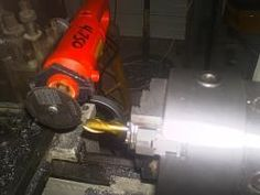 Rotary Cutter Tool Post Mount by Neil Jensen -- built bracket to mount rotary cutter on toolpost mainly to sharpen end...