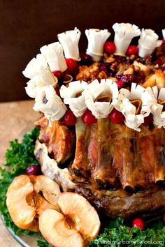 Crown Roast of Pork - the ultimate meat centerpiece for your holiday dinner. Impressive yet easy to prepare. It's time to bring the old classic back! Crown Pork Roast Recipes, Crown Roast Of Pork, Pork Recipes, Gourmet Recipes, Cooking Recipes, Dishes To Go, Pork Dishes, Holiday Dinner, Pork