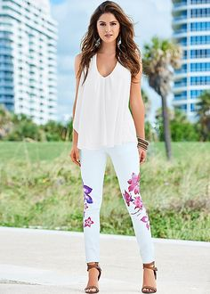Who says you can't wear a white top with a white bottom? :) Venus ruffle front tank with painted floral skinny jean.