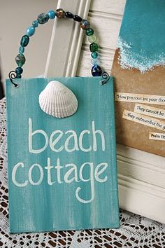 Cute beach cottage sign.