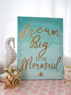 Hand-lettered Mermaid Nursery Wall Decor in Aqua Ombre and Gold. Dream big little mermaid. 11x14 gold and aqua nursery wall decor. Beach home decor for mermaid lovers. New canvass will be similar but not exact because of each needs to be painted by hand. Please allow up to 5-7 days to paint and ship once item is cleared payment. All Rights Reserved! Sale of my artwork does not transfer rights to buyer to resell or copy prints or images.