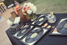 Vinyl LPs as alternative guest book.  These would look cool hanging on a wall!
