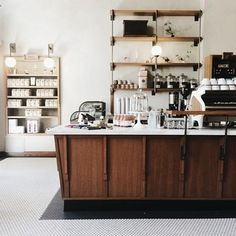The industrial shelving and modern counter at Sightglass Coffee in San Francisco. | 31 Coffeeshops And Cafés You Wish You Lived In