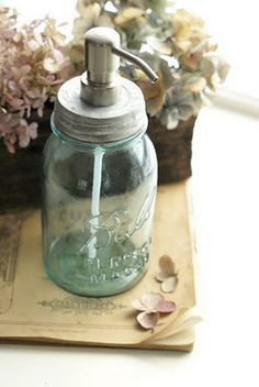 """Ball Mason jar soap dispenser - ordered the pumps online from onedreamdesign.com, drilled a hole in the top of the lid where the """"bump"""" is, and then sealed the pump with hot glue.  I think I used a pint sized wide-mouth mason jar.  I want to make some using the blue mason jars and the narrow mouth jars."""