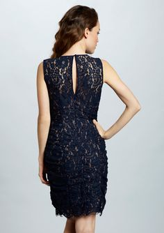 """Navy Lace Side-Ruched Dress by Eliza J, via Ideeli.com; $80. Above the knee; front is very simple, w/collar-bone level round neck. Ruching is subtle. And call me tastless but I think this dress is both seasonless and ageless, depending on accessories. So maybe you need a dress for """"that thing"""" you've got coming up?"""