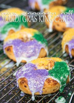 Mini Cinnamon Roll King Cakes are an easy Mardi Gras treat any time of day! Transform cinnamon rolls into festive treats with this easy recipe - laissez les bon temps rouler!