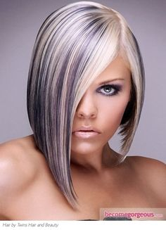 This platinum blonde hair with purple highlights serves as an A-list beauty option to glam up your look. Spread the tinted sections all over the locks for a versatile and edgy effect.