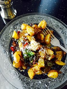 Fried potatoes, veggies,  meat and cheese