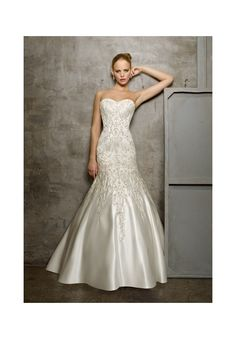 Wedding Dresses and Wedding Gowns by Morilee featuring 2512 Duchess Satin with Embroidery Intricate embroidery adorns the sweetheart bodice of this fit and flare Duchess Satin gown, giving it a lavish and regal feel. A traditional corset closure finishes the back. Colors Available: White/Silver, Ivory/Silver.