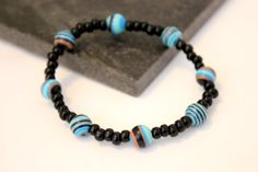 Black and turquoise beaded elasticated by allanamphotography, £3.00