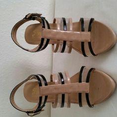 Tan and black sandal Tan and black sandal, 4 inch heel,  size 7 Fashion Shoes Heels