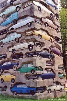 """long term parking"" 60 cars  18m (60-ft.) high, 60 cars embedded in concrete. Montcel, Jouy-en-Josas, France."