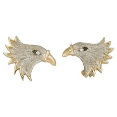 Majestic eagle earrings that have .12cttw diamond eyes and leverbacks