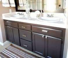 I painted my honey oak builder cabinets a dark espresso cabinets.  LOVE!!  not my pic, but I used a lot of the information from this site to get started.