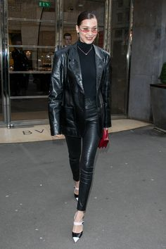 Head-to-toe leather? Yes, Bella! Show 'em how it's done. We're loving her edgy off-duty looks while in France, she is in full to Parisian chic mode - black turtleneck and all.