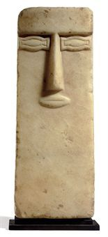 1 CENTURY B.C.-1ST CENTURY A.D. Yemen A SOUTH ARABIAN ALABASTER ANTHROPOMORPHIC STELE In the form of a stylized rectangular face, with the facial features sculpted in raised relief.