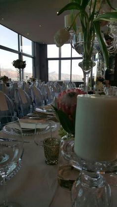 Table setting and guests overlooking Helderberg.