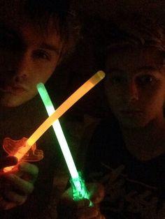 Michael Clifford and Luke Hemmings. Sword fight. (Jk Light Saber)