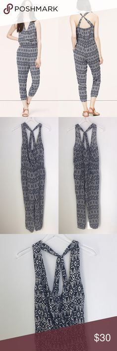 """[LOFT] Sightseer Jumpsuit Ikat Tribal Print Boho Sleeveless, cross back jumpsuit. Crossover front. Elasticized waistband and cuffs. Relaxed fit. Tribal Ikat print. Navy,  🔹Bust: 18"""" 🔹Waist: 15"""" 🔹Rise: 10"""" 🔹Inseam: 26"""" 🔹Full Length: 52"""" 🔹Condition: Excellent pre-owned condition.  *LL24 LOFT Pants Jumpsuits & Rompers"""