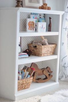 could do bookcase with curtains on either side mounted on ceiling with extra nook space on either side or storage for toys hidden - Baby Room Bookshelves
