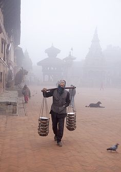 Life at Bhaktapur #nepal #photography this guy is carrying yogurt in terracotta pots. both are made in Bhaktapur. THE BEST yogurt you will ever have.