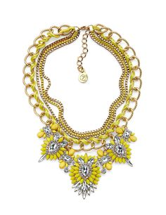 The Blonde Ambition Necklace will really turn heads! Bright yellow with crystal embellishments and woven fabric.