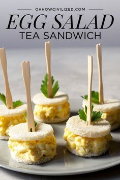 A classic egg salad sandwich can be found on many afternoon tea menus. Make this… A classic egg salad sandwich can be found on many afternoon tea menus. Make this simple yet delicious egg salad tea sandwich for your next tea party. Salat Sandwich, Egg Salad Sandwiches, Finger Sandwiches, High Tea Sandwiches, Tea Party Sandwiches Recipes, Sandwich Platter, Picnic Sandwiches, Steak Sandwiches, Healthy Sandwiches