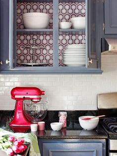 A Modern, Coastal Kitchen Remodel (On a Budget) : Home Improvement : DIY Network  I love the wallpaper on the back of the shelf interior, but it's probably way more work than I would have the patience for. #GlassShelvesBackSplashes