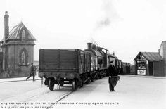 A train of empty coal trucks returning from Clifton colliery to the LNER goods yard at Queen's Walk guarded by a flagman as it crosses the road past the toll gate at Wilford Road junction by the River Trent. Steam Locomotive, Derbyshire, Nottingham, Past, Street View, River, Kiosk, History, Crosses