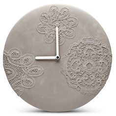 Large minimalist concrete wall clock with beautiful delicate lace patterns and white hands, designed and hand-made in The Netherlands.