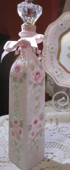 Pretty pink perfume bottle painted with roses, prism beads and satin ribbon. Karen Fleming