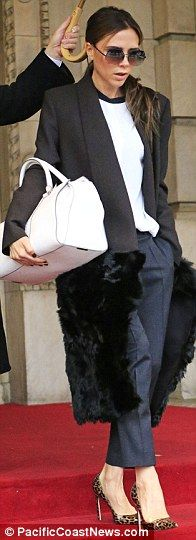 Victoria Beckham wears dramatic fur bottomed coat on morning of second show…