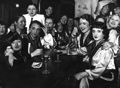 A group of women celebrate a réveillon in Paris, circa 1925. A réveillon is a dinner party preceding Christmas and New Year, at which luxury foods and wines are often served.