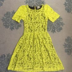 ASOS neon yellow lace fit and flare Looks amazing with black tights and black booties. Fitted in waist, zipper up back. ASOS Dresses