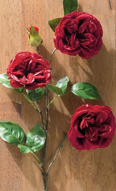 Lifelike rose stems are a romantic addition to any Christmas tree or holiday arrangement.
