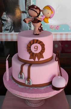 Pink and brown cake at a cowgirl birthday party! See more party ideas at CatchMyParty.com!