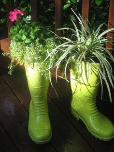 An old pair of men's rubber boots with drain holes drilled in the bottoms and spray painted make a whimsical garden planter!