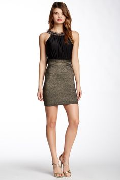 "Details:  - Crew neck with chain link jeweled trim  - Sleeveless  - Concealed back zip closure  - Draped back  - Banded skirt  - Approx. 34"" length  - Imported  Fiber Content:  Self: 90% polyester, 10% spandex  Skirt: 70.6% viscose, 11.6% nylon..."