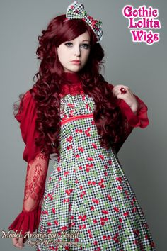 (http://www.gothiclolitawigs.com/duchess-collection-burgundy/)  Horrible dress. The wig would work more with a tamer-like outfit