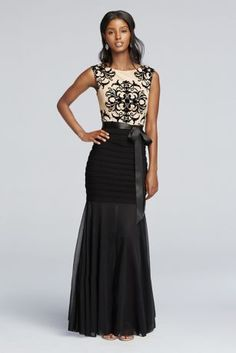 Set a new standard for opulence in this head turning partydress!  Sleeveless flocked lace bodice with anintricate design.  Banded jersey skirt with sheer trumpet creates a flattering silhouette.  Sash at waist adds an ultra-feminine touch.  Fully lined. Back zip. Imported polyester. Professional spot clean. No direct heat or steam.