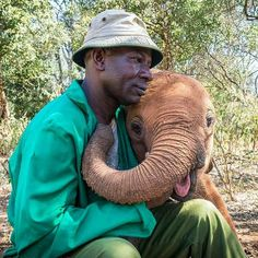 I can't handle how adorable it is. .@enormouselephantrun - Even elephants need hugs and at the @dswt Keepers are on hand around the clock to ensure that newly rescued orphaned elephants get the top-notch care and nurturing presence (and yes lots and lots of hugs!) that they need to survive and also thrive. Photo David Sheldrick Wildlife Trust / Martin de la Torre For info about promoting your elephant art or crafts send me a direct message @elephant.gifts or emailelephantgifts@outlook.com…