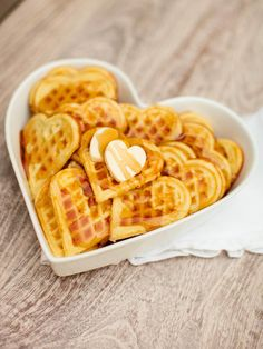 Wake up your loved one with fluffy, heart-shaped homemade waffles covered in sweet maple syrup. Get the recipe at DIYNetwork.com.