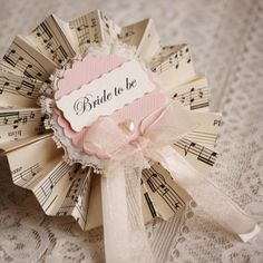 Bridal Party Rosettes...handcrafted from vintage music sheets, lace, sheer ribbon and pearl hearts. Perfect for vintage themed bridal showers or hen parties. Love!!!!