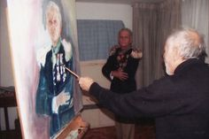 Spanish artist painting with left hand