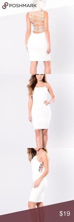 """fashion nova white dress """"check out my back"""" white bodycon dress with stringed back. never worn. Form fitting in good condition , runs smaller for a large size Fashion Nova Dresses Backless"""