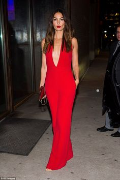 Red hot! Lily Aldridge looked devilishly sexy in a perilously plunging gown as she joined leggy Victoria's Secret Angels Nina Agdal and Jourdan Dunn in Tribeca, New York City on Tuesday