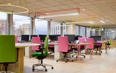 The light fixtures are really interesting. Custom? Wink Office by Stone Designs, Madrid   Spain office